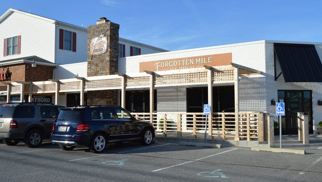 The Forgotten Mile Ale House boasts gourmet comfort food, 14 taps and a large selection of craft beer, bottles and cans.