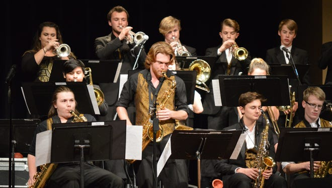 Shown is the T.L. Hanna High School Jazz Ensemble with tenor saxophonist, Bradley Foster standing during the performance. Foster was named outstanding soloist.