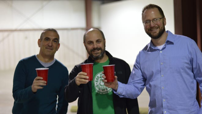 The owners of Fretboard Brewing Company.