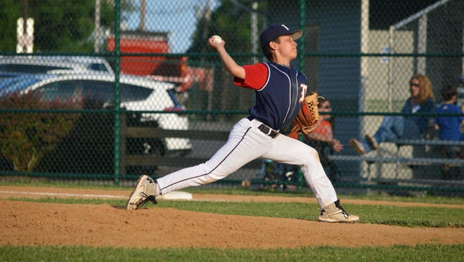 Dylan Ah Now tosses a pitch for Millburn.