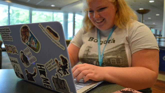 Ella Fredrickson, 18, works on a story at the Iowa Young Writers' Studio in Burge Residence Hall on Wednesday, July 12.