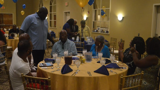 """Southern football coach Dawson Odums chats with alumni and supporters during """"Meet the Jaguars"""" Thursday in Alexandria."""