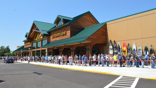 """A line of shoppers eager to see the new Cabela's store in Chesterfield Township on Monday during the store's """"Friends and Family"""" preview on July 31, 2017."""