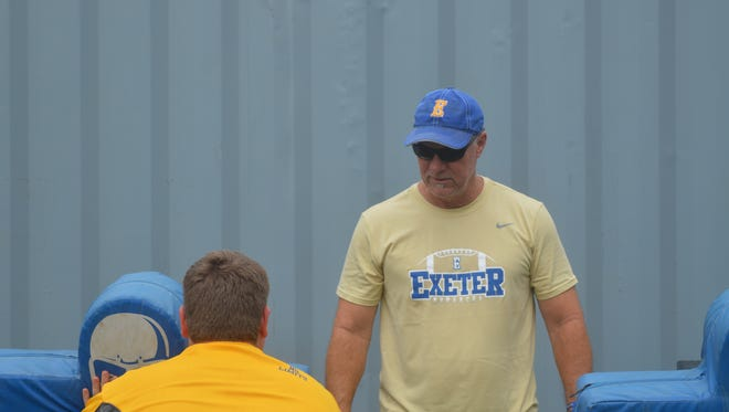 New Exeter head football coach Keirsten Lamb directs a defensive line drill on Aug. 2 in Exeter.
