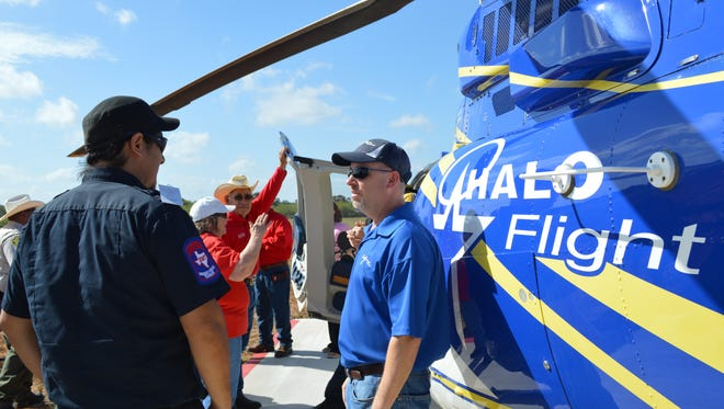 Community supporters at the Premont pad ribbon cutting get an up-close tour of a HALO-Flight air ambulance unit with Chief Medical Officer Randy Endsley and the flight crew, Mark Ritter, Jeremiah Williams and Derrek Buckholt.
