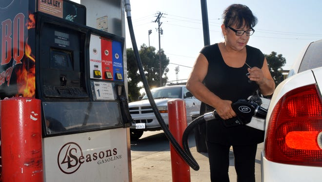 Sherry Chavarria drives from Dinuba to fill up her tank with gas from 4 Seasons Handy Market in Visalia.