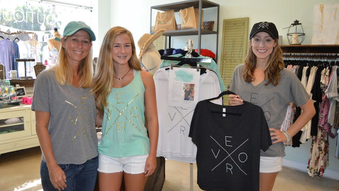 Messina and Lily Shields stand with Seahorse Lane Boutique owner Audrey Mose, each modeling her own VERO shirt.