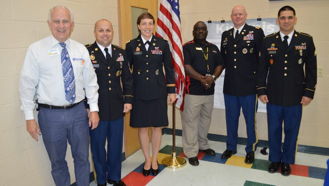 C. David Elliott, Kentucky-Tennessee District Division 14 Lieutenant Governor, poses with local Army representatives after Thursday's Hilldale-Clarksville Kiwanis Club meeting. Shown here (left to right) are: Elliott; 1st Sgt. Shawn Wilkerson; Capt. Rebekah Thomas; Julius Kelley, APSU ROTC; Lt. Col. Kevin Polosky; and Sgt. Alejandro Zavala.