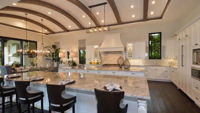 Sunwest Homes' two-story Santa Barbara Grande estate model in Talis Park's Prato neighborhood is available in the North Naples community developed by Kitson & Partners.