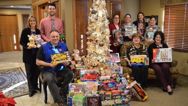 Staff from Rose Bertram LLC, The Fond du Lac Area Retirement Planning and Investment Resource  collected food and toys for The Salvation Army and the Solutions Center. Pictured are, seated, from left: Ron Jacobson, The Salvation Army of Fond du Lac; Rose Bertram; and Jody Gindt, Solutions Center; standing: Judy Hanson, Gregory Vidmar, Amy Hanson, Jennifer Hays, Jessica Geiszler and Tina Faye Moore.