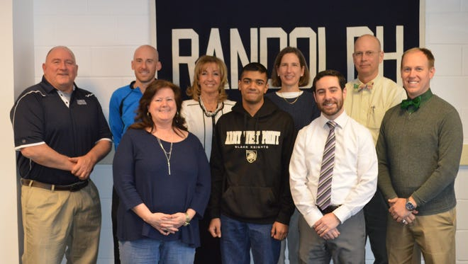 Randolph High School senior Ajay Hariharan, center, with teachers and coaches after receiving his Congressional appointment to West Point.