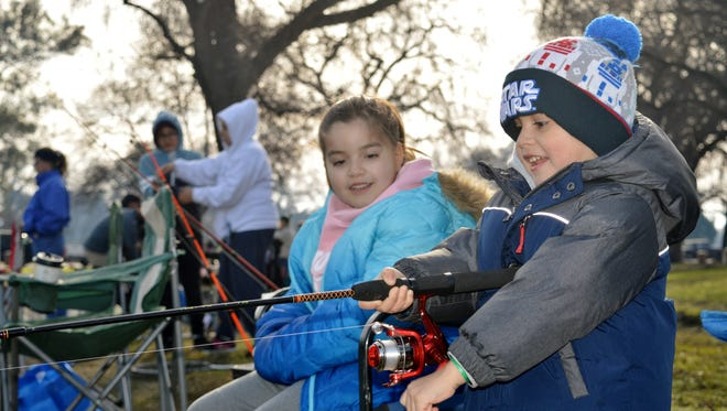 Daniel Hernandez, 3, reels in a fish Saturday morning during the Annual Winter Trout Fishing Derby at Plaza Park.