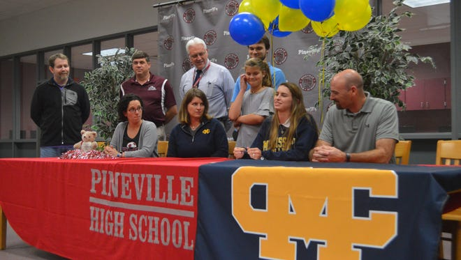 Pineville Emma Robinson (first row, second from right) signed with Mississippi College.