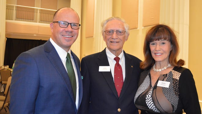 Jeff Pickering with John and Kathi Schumann, recipients of the Spirit of Philanthropy award.