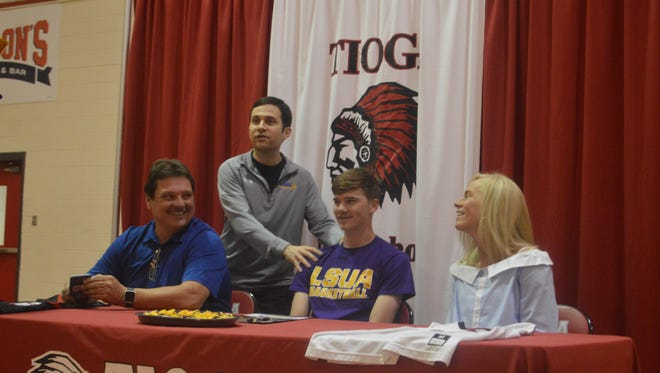 LSUA coach Larry Cordaro (standing) talks about Tioga guard Dustin Roy Tuesday. Roy signed with the Generals.