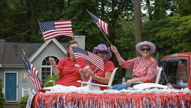 A group of women ride a float in the Ocean Pines 50th Anniversary Parade along Ocean Parkway on June 2, 2018.