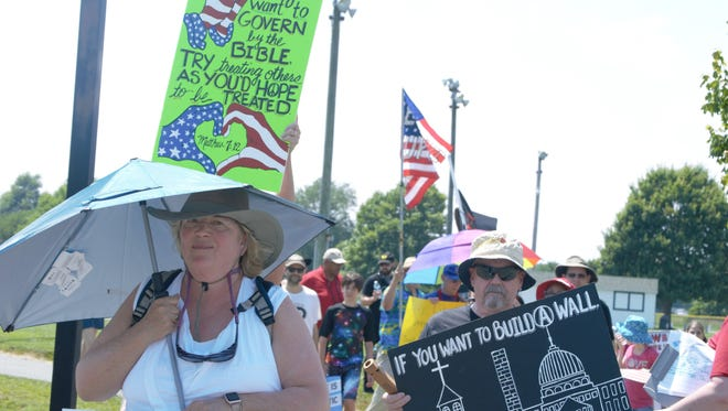 """Protestors march to the Worcester County Detention Center in Snow Hill, Maryland for the """"End Immigrant Detention"""" protest on July 1, 2018."""