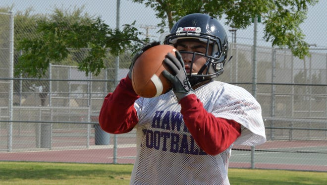 Mission Oak High senior Bobby Mascorro catches a pass during practice on Wednesday in Tulare. Mascorro is the Hawks' starting running back.