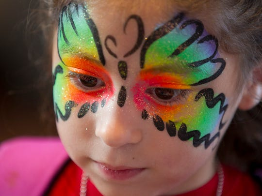 RJ Lugo, 5, of Chandler, had her face painted during the anniversary celebration.