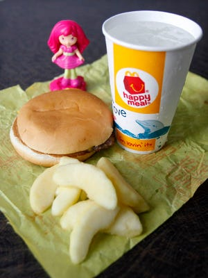 McDonald's says it has sold nearly 2 billion servings of fruit and yogurt since making changes in 2011 to make its Happy Meal for kids more healthy.