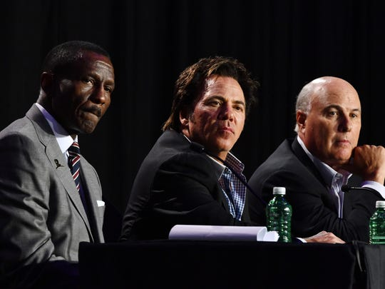 From left, Pistons coach Dwane Casey, Tom Gores and Ed Stefanski.