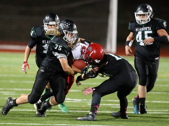 Klahowya defensive lineman Collin Deutscher makes a tackle during Friday's game against Port Townsend.
