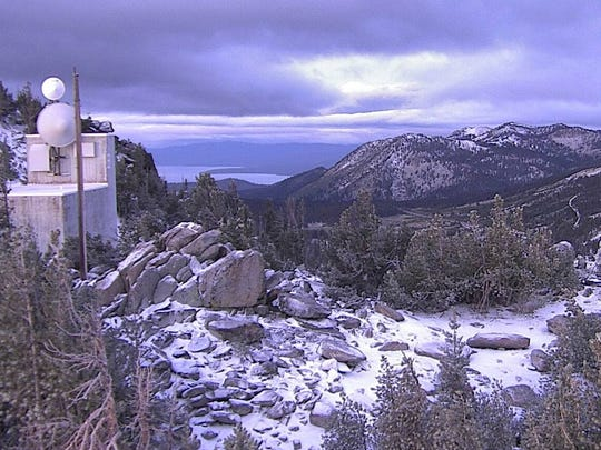 This Alert Tahoe fire camera photo from Sept. 21, 2017 shows a dusting of snow on Slide Mountain near Reno. Lake Tahoe visible in background.