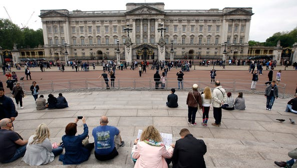 Tourists around Buckingham Palace in London, Thursday,