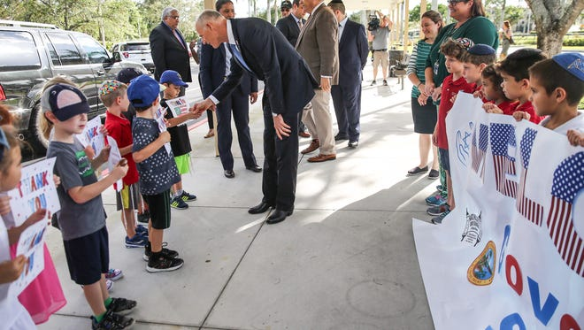 Gov. Rick Scott shakes hands with students from Katz Hillel Day School in Boca Raton, where he gave a speech proposing $1 million of the recommended 2018-19 budget be allocated toward beefing up security at Jewish day schools.