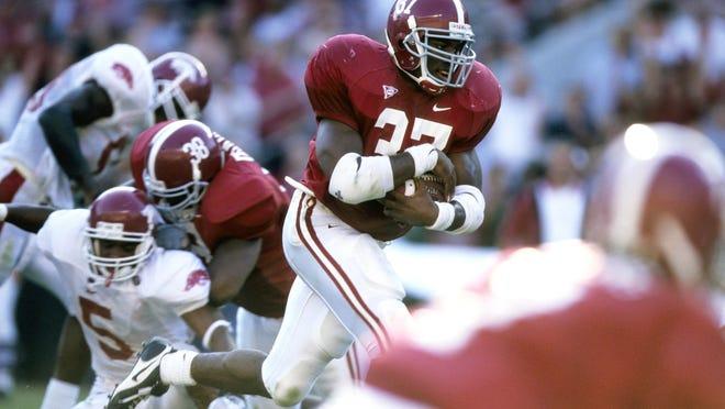 Sep 27, 1997; Tuscaloosa, AL, USA; FILE PHOTO; Alabama Crimson Tide tailback Shaun Alexander (37) in action against the Arkansas Razorbacks at Bryant-Denny Stadium. Mandatory Credit: RVR Photos-USA TODAY Sports