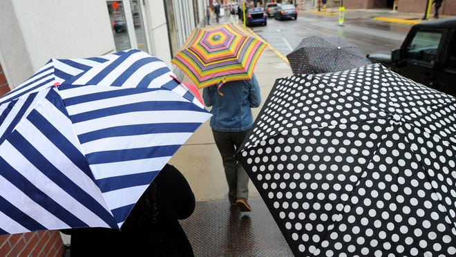 People walking to Central Market use umbrellas to keep dry during a rainy Thursday, Oct. 1, 2015.  Jason Plotkin - York Daily Record/Sunday News