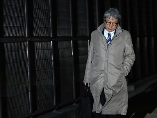 In this Thursday, Dec. 20, 2018, file photo, Motonari Otsuru, defense lawyer of former Nissan chairman Carlos Ghosn, leaves Tokyo Detention Center where Ghosn and another former executive Greg Kelly are being detained in Tokyo.