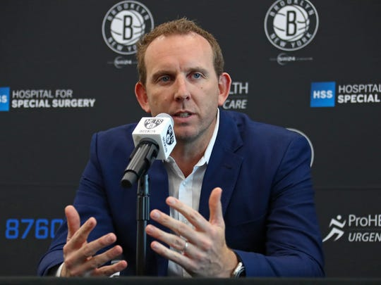 BROOKLYN, NY - JUNE 26:  Sean Marks, GM of the Brooklyn Nets, introduces D'Angelo Russell and Timofey Mozgov during a press conference on June 26, 2017 at HSS Training Center in Brooklyn, New York. NOTE TO USER: User expressly acknowledges and agrees that, by downloading and or using this Photograph, user is consenting to the terms and conditions of the Getty Images License Agreement. Mandatory Copyright Notice: Copyright 2017 NBAE (Photo by Nathaniel S. Butler/NBAE via Getty Images)