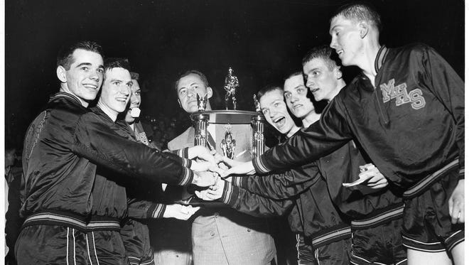 Milan High School  teammates celebrate after winning the state high school championships on March 20 1954.