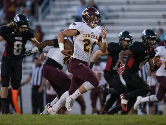 Central's Michael Bickford runs to the end zone. Central