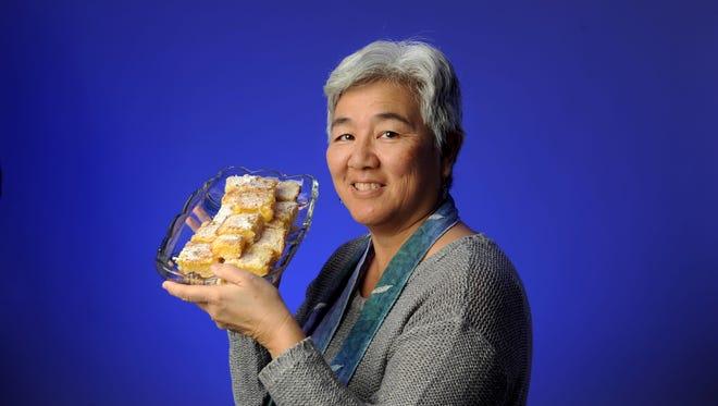 Cook du jour Kathy Jonokuchi displays her lemon bars.