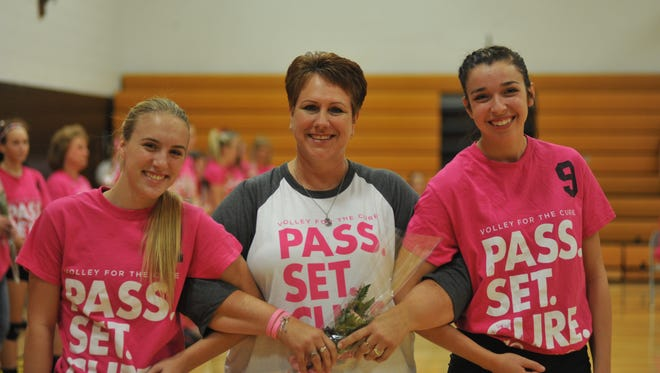 Amber Christy, accompanied by Hailey Ratliff (left) and Jenna Siegel (right), was honored prior to the game alongside numerous other survivors.