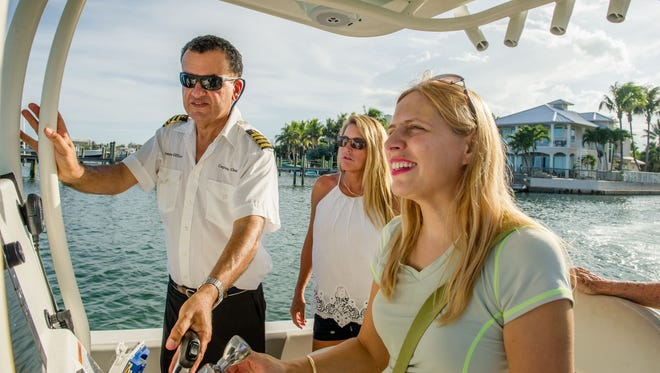 Women on Water attendees get instruction docking the boat