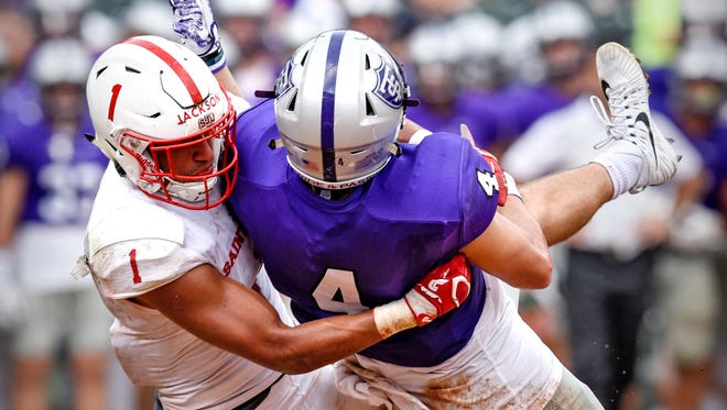 Max Jackson (1) of St. John's breaks up a pass to St. Thomas receiver Vinny Palllini in the teams' 2017 game at Target Field in Minneapolis. Jackson is a preseason All-American for the Johnnies.