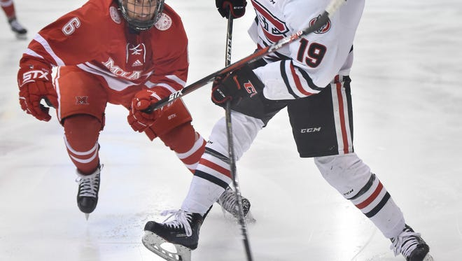 St. Cloud State's MIkey Eyssimont takes a shot against Miami's Alec Mahalak during the first period of the Sunday, March 11, game at the Herb Brooks National Hockey Center in St. Cloud.