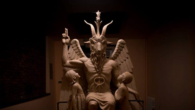 The Satanic Temple aims to place this statue of Baphomet, a goat-headed deity, at the Oklahoma State Capitol in response to Christians installing the Ten Commandments there. The Satanic Temple recently started a Detroit chapter, the first of 15 planned across the U.S.