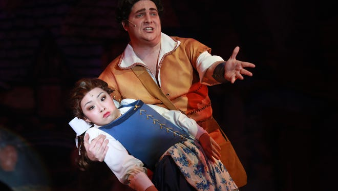 "Kendyl Yokoyama as Belle and David Hatfield as Gaston in ""Beauty and the Beast."""