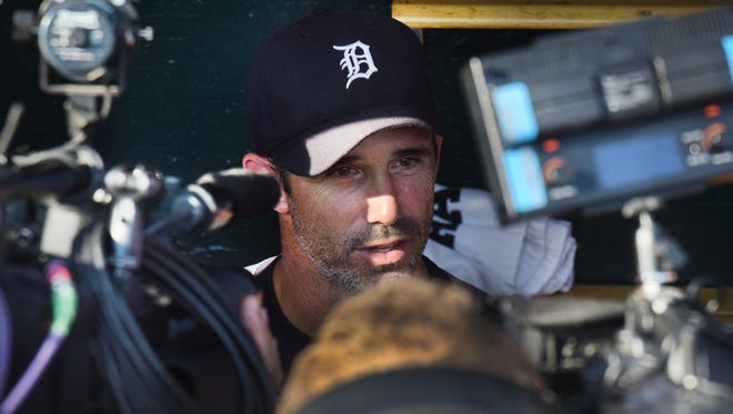 Detroit Tigers manager Brad Ausmus talks to the media in the Tigers dugout after the announcement that his contract will not be renewed at the end of the season.