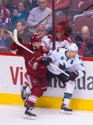 Coyotes' Brendan Shinnimin (39) fights for a puck with Sharks' Joe Pavelski (8) in the second period at the Gila River Arena in Glendale on February 13, 2015.