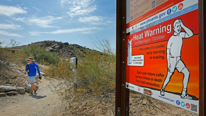 Frank Brown braves the heat to hike Tuesday, June 21, 2016 at South Mountain Park in Phoenix,  Ariz.  Intense temperatures can make for a dangerous hike. Phoenix is considering shuttering hiking trails when temps reach 110 degrees.
