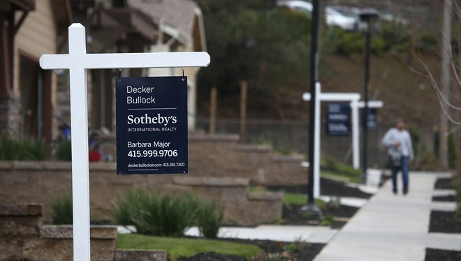For sale signs are posted in front of a newly built homes  in Novato, Calif.