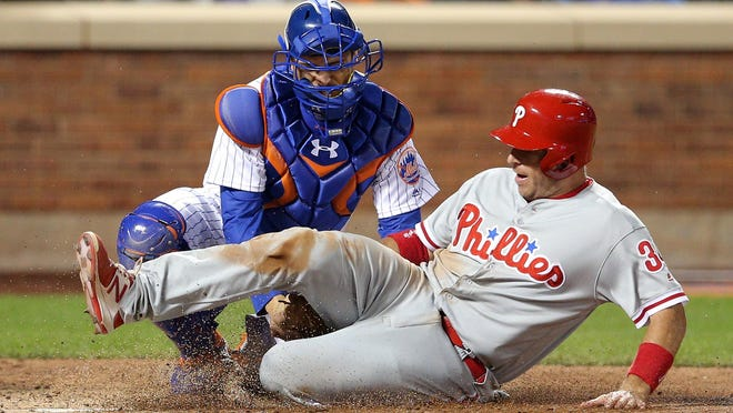 New York Mets catcher Travis d'Arnaud tags out the Phillies' A.J. Ellis during the seventh inning of Saturday night's game at Citi Field.