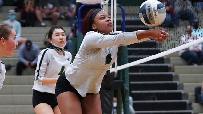 Connally's Michera Moffett passes the ball against Bastrop in a home volleyball match Nov. 3. The Cougars beat the Bears in three sets, 25-12 25-21, 25-19.
