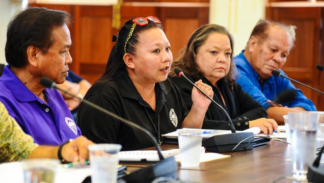 Maefe Muyco, second from left, Department of Public Health and Social Services supervisor, express her the difficulties during a joint roundtable meeting with social service professionals and island lawmakers at the Guam Congress Building in Hagåtña on Tuesday, April 17, 2018.