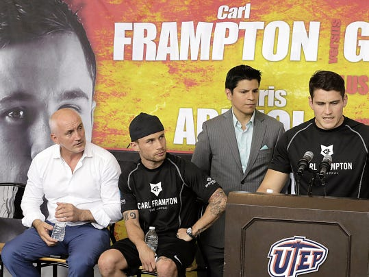Barry McGuigan, Carl Frampton llok on as Shane McGuigan addresses members of the media and fans on hand at the Don haskins Center Thursday afternoon and promises that his fighter Frampton will come out of Saturdays fight with a win against Alejandro Gonzalez Jr.